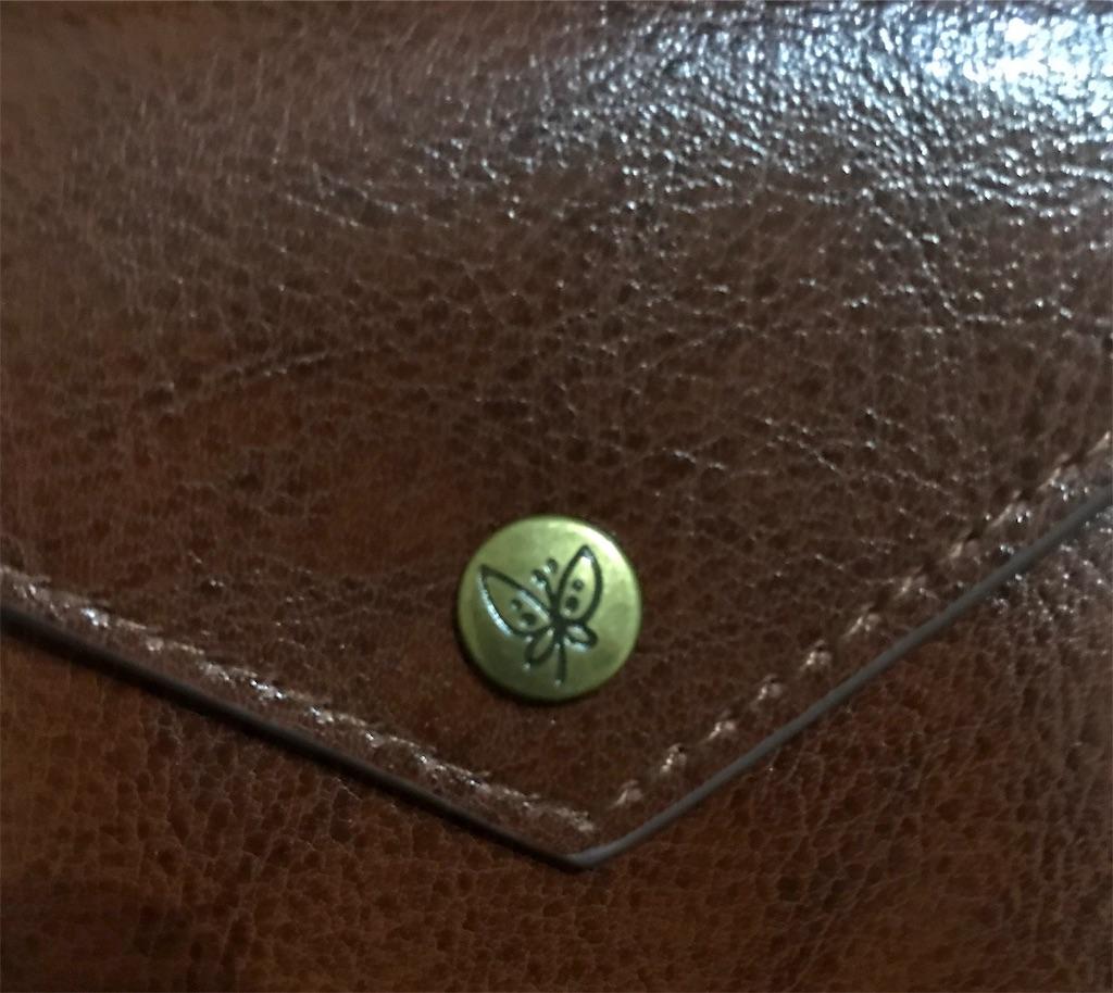 ムーミンミニ財布ボタン蝶